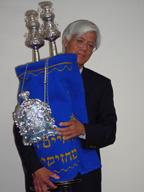Rabbi holding torah 1